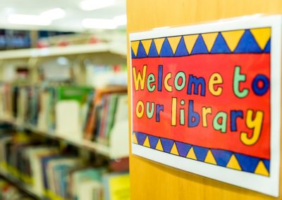Welcome to our library sign