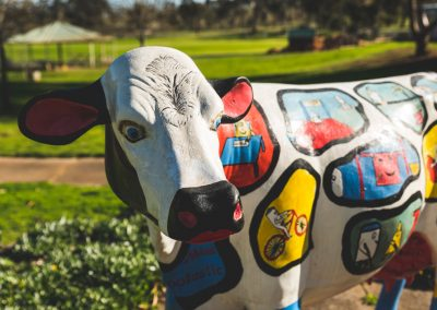 Ornamental cow on school yard painted with several colours